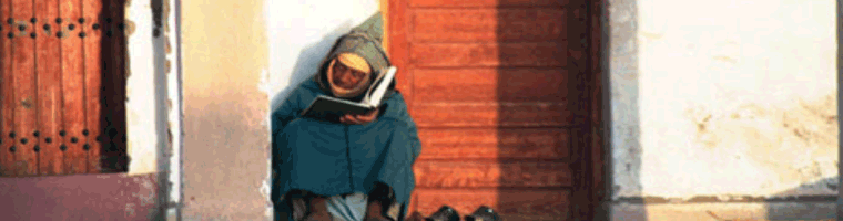 Site banner :: image of man reading, Rabat Morocco