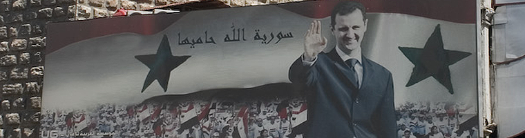 Site banner :: image of Assad poster, Damsacus Syria
