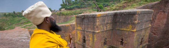 Site banner :: image of priest and rock church, Lalibela, Ethiopia